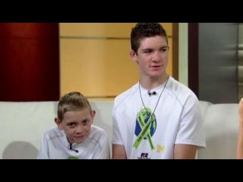 Teen carries brother with cerebral palsy on 111 mile trek