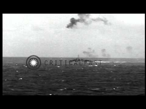 US Task Force 38.3 battleship, destroyer and light cruiser fire antiaircraft on J...HD Stock Footage