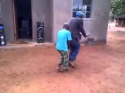 Zimbabwean father and son dancing sungura