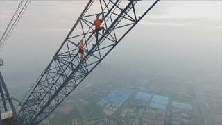 Download Couple Illegally Climb World's Tallest Construction Site With No Harness Mp3 and Videos