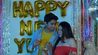 Cute Indian couple happily enjoying and celebrating New Year with drinks in India