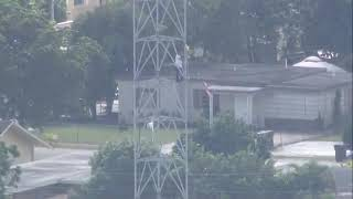 Florida man climbs up cellphone tower, police on scene