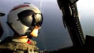 SIT NEXT TO PILOT WHEN HE LANDS ON AIRCRAFT CARRIER