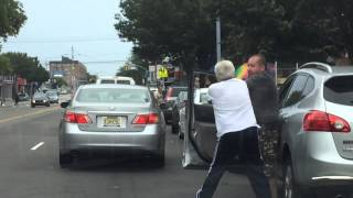 Two men fighting over parking
