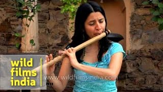 Nathalie plays Indian bamboo flute (bansuri)