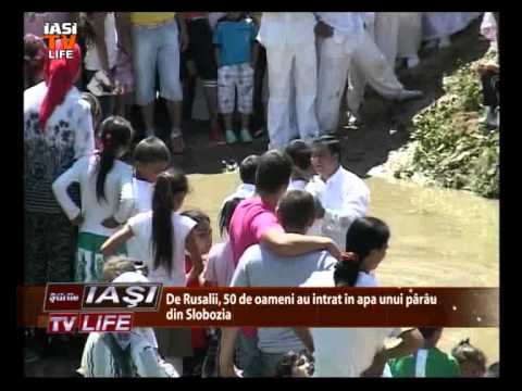 Botez colectiv in garla, pe ritmuri lăutăreşti şi versuri religioase