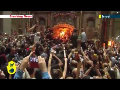 Holy Fire in Jerusalem: Orthodox Christians celebrate annual Easter miracle in Old City