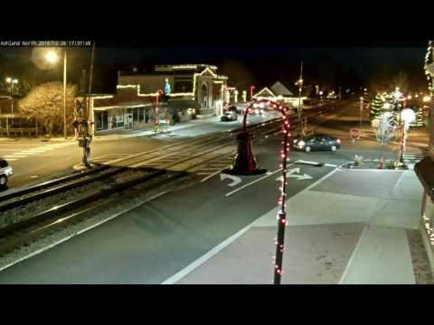 Car doing slide on railroad tracks