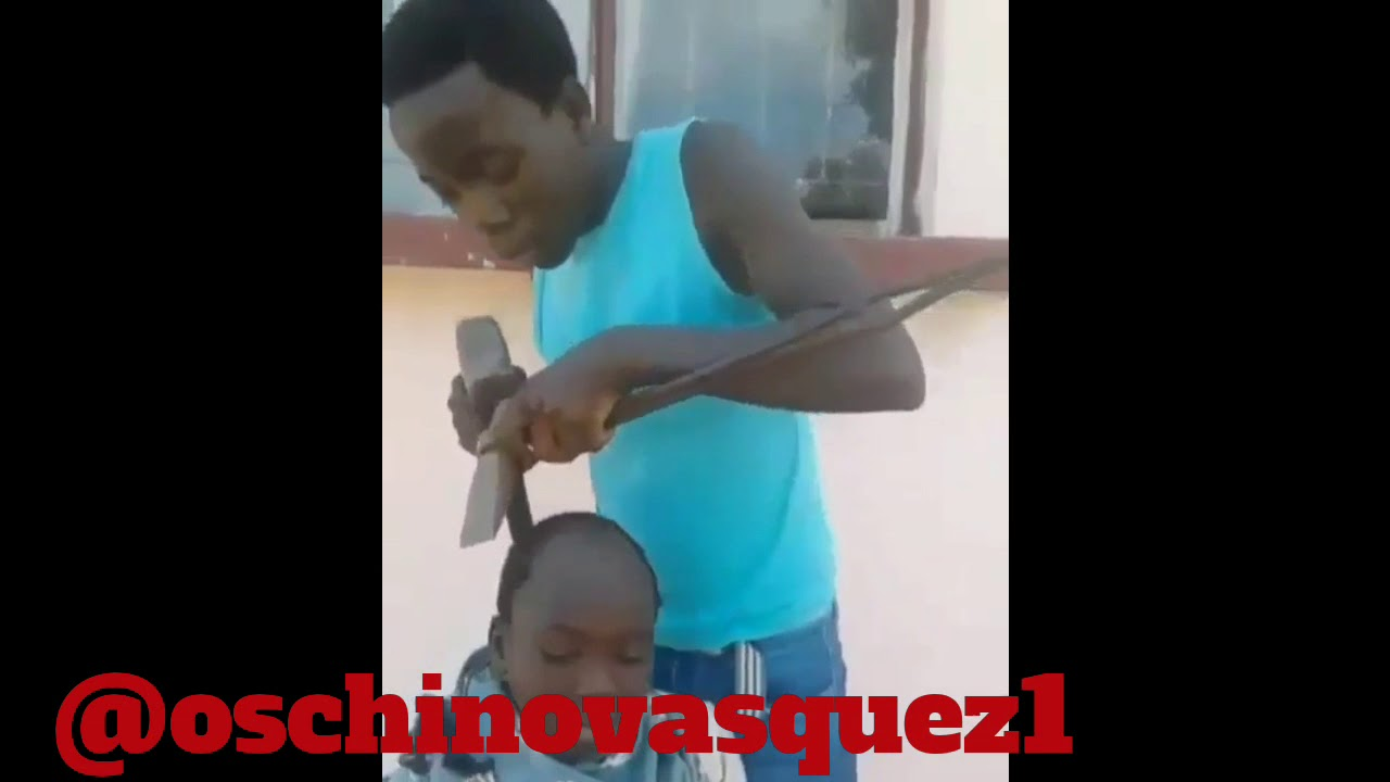 AFRICAN HAIRCUT WITH CHISEL AND HAMMER
