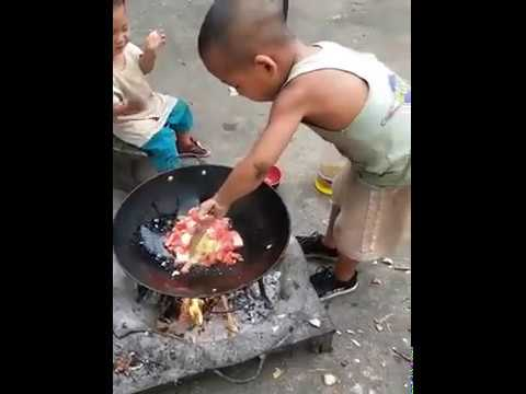TOUCHING! 7 Years Old Boy Cooking For His Younger Brother