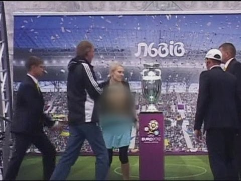 Topless woman tries to steal Euro 2012 cup