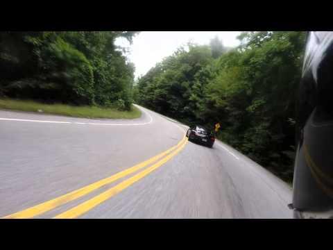 KTM RC8 Chasing A Porsche up Blood Mountain
