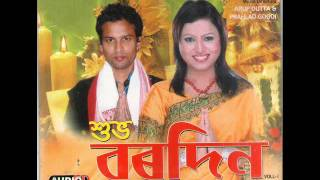 Christmas song (Assamese) singer Zubeen Garg and Mainu Devi (Duet song only) Album : Huva Bordin