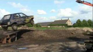 Peugeot 205 jumps into puddle of mud