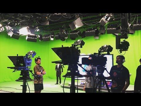 HD news studio green screen background with television newsroom set lighting