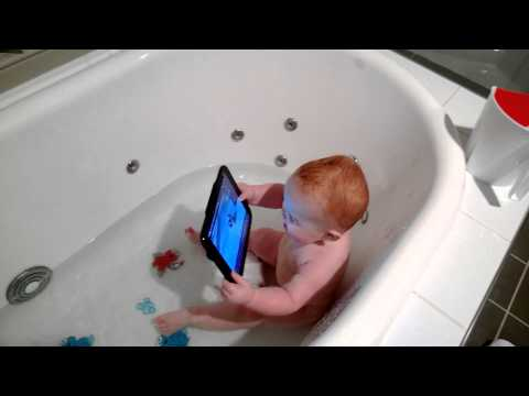 Keira playing with her tablet in the bath. Watching Baby Monkey Riding on a Pig.