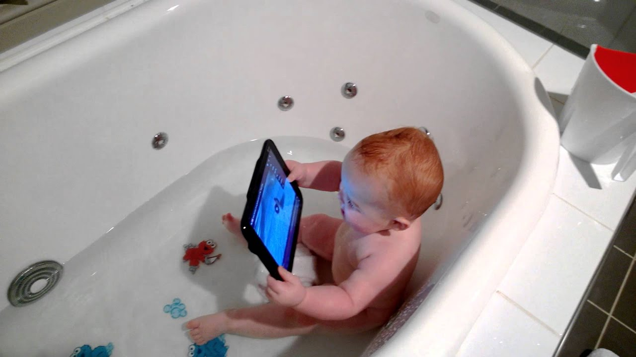 Keira Playing With Her Tablet In The Bath Watching Baby Monkey Riding On A Pig
