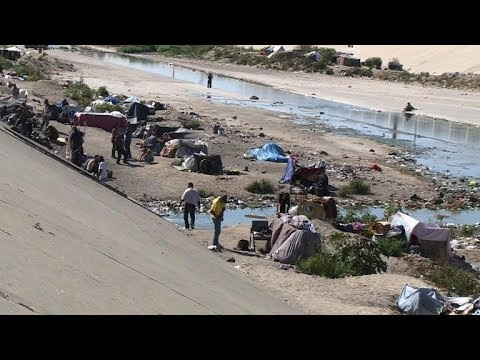 Hundreds of Mexican deportees end up living in Tijuana canal