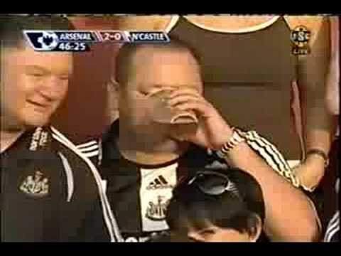 Newcastle owner Mike Ashley has a beer