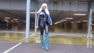 DANA LABO the woman in black , catwalk in blue boots, vinyl leggings and leather jacket
