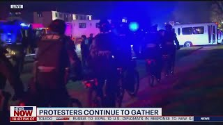 Brooklyn Center Protests: Crowds cut fence open, unlawful assembly declared