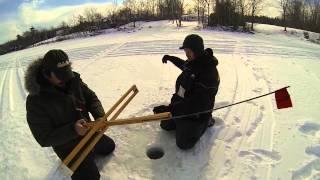 Rusty battles a Swan Lake togue