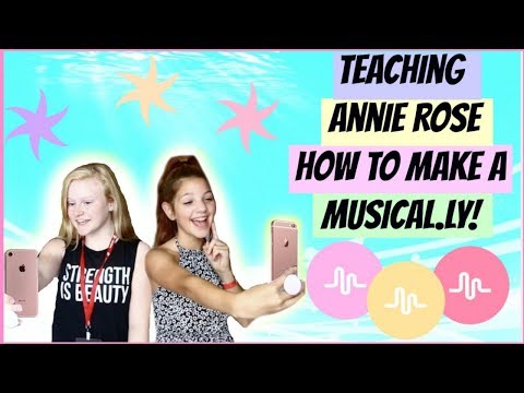 Teaching Annie Rose how to make a Musical.ly!