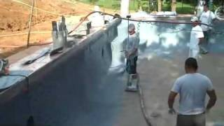 Pebble Tec being applied to a swimming pool