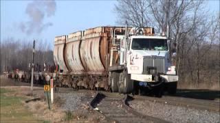 CN Hi-Rail Boom Truck Pulling Wisconsin Central Rail Flats and Gondolas