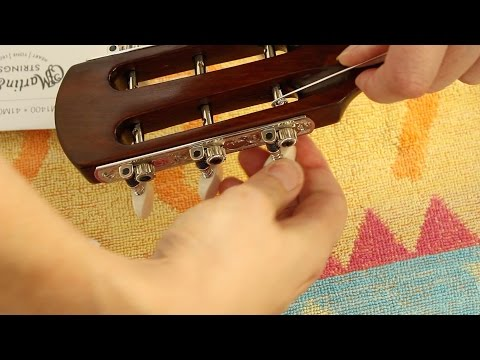 Restoring an antique parlour guitar part 43: Stringing