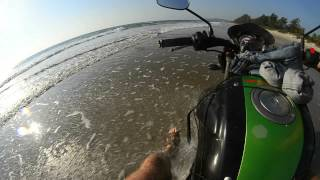Ride on bike in Paradise beach, India, Maharashtra, 2013