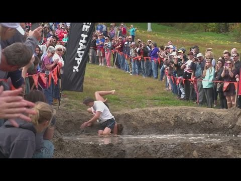 Husbands dropping wives at the North American Wife Carrying Competition