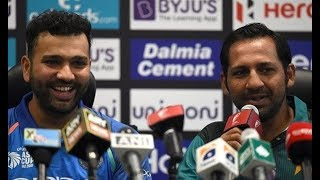 Sarfraz Ahmed & Rohit Sharma passing smiles just before Asia Cup 2018