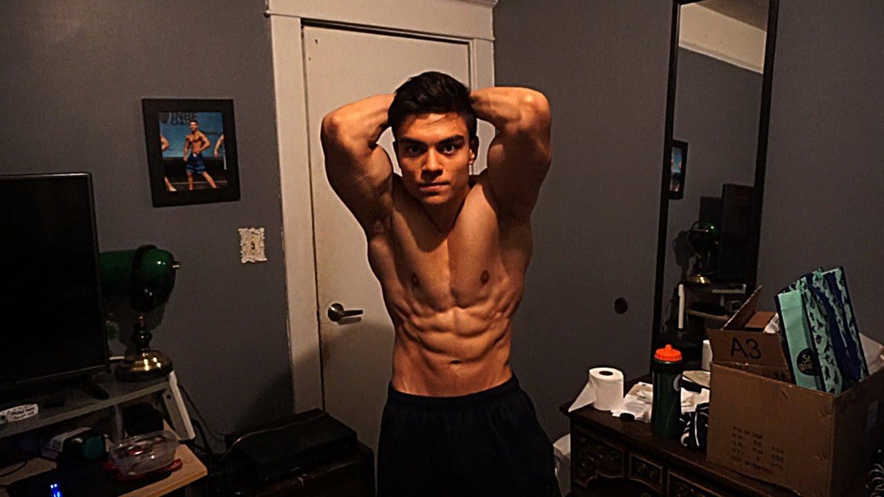 Ripped aesthetic junior bodybuilder - shoulders training