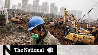 China rushes to build coronavirus hospital as lockdowns increase