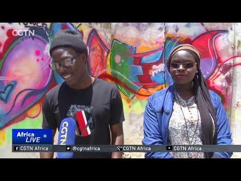 Female graffiti artist promotes women's rights in Dakar