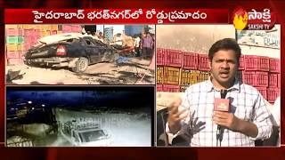 Car Skipped From Bharat Nagar Flyover   Hyderabad   Sakshi TV