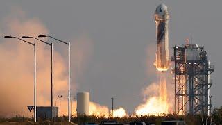 Billionaire Jeff Bezos blasts off on space travel company's first flight