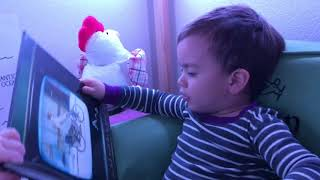 Penn tries to read Marcel the Shell with shoes on book to baby brother Bo :)