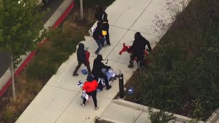 Looters fight over clothes in California