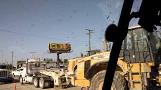 Loader fell off trailer in bartlesville Oklahoma