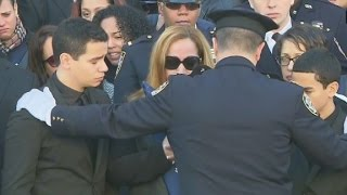 Officers carry casket, salute Ramos family