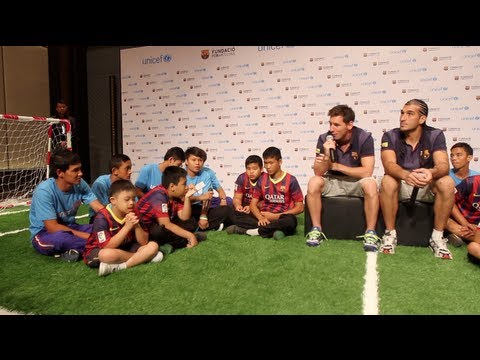 Children Practise Football With Messi And Pinto