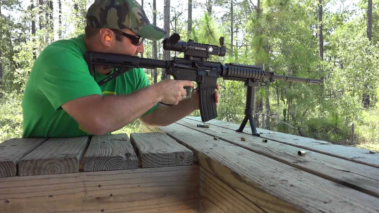Shooting Bushmaster AR15 Assault Rifle  223 | Leupold Mark 4 CQ/T