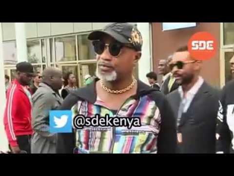 Drama: Koffi Olomide kicks female dancer after landing in Nairobi.