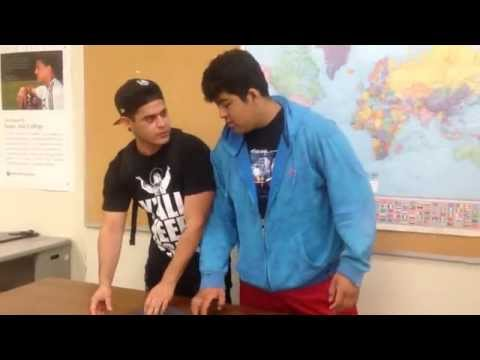 Santa Ana college students teach you how to fold a shirt