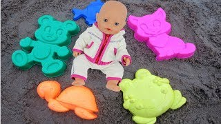 Ulyana and Baby Doll Playing with Sand Molds and Learning colors for toddlers