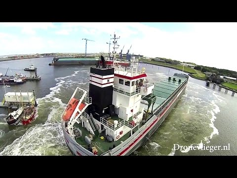 Docking of a big Offshore  ship seen by a drone - Dronevlieger.nl
