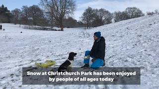 Snow sledging at Christchurch Park in Ipswich