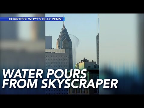 Sylvia Chacon - Water Caught on Camera Gushing from Side of Skyscraper onto Sidewalk Below